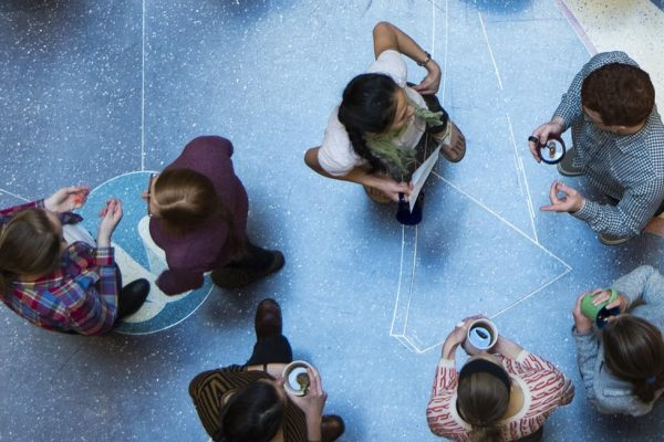 Overhead shot of students gathered at tea time