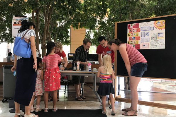 Photo of students performing science outreach
