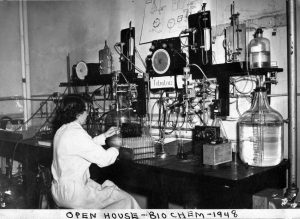 Historical archive photo of woman at lab bench