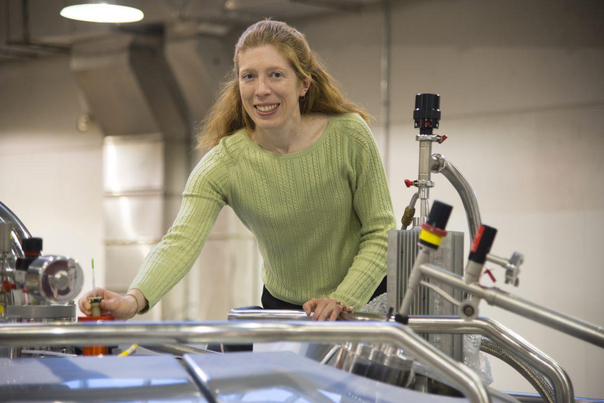 Photo of professor using NMR facility
