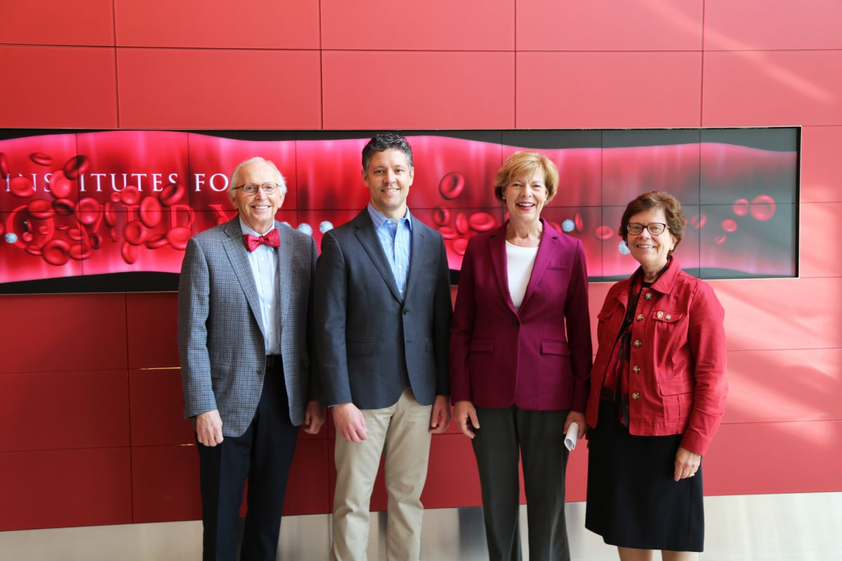 Faculty and Chancellor posing with Senator Baldwin
